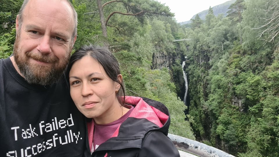 A man and a woman in front of a deep gorge