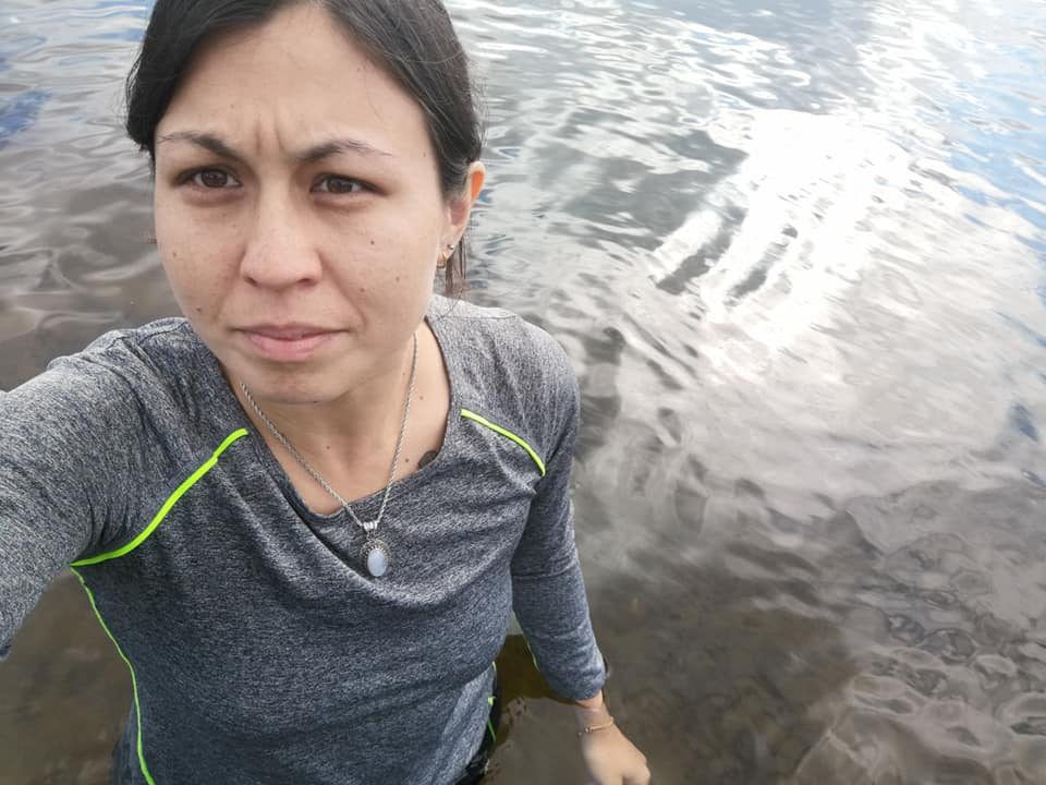 A woman standing in hip-deep water